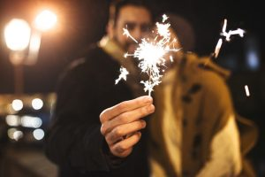couple with sparkler for the new year