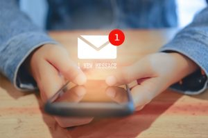 Woman hand using smartphone got 1 new message email. Business communication technology concept.