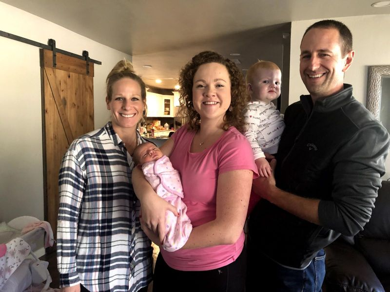 Birth mother Lindsey with baby Charlotte and the adoptive family