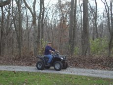 Adoptive Family Photo: Bill Riding the Four-Wheeler, click to view bigger version