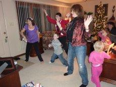 Adoptive Family Photo: Having Fun Playing Just Dance on Wii, click to view bigger version