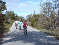 Adoptive Family Photo: Laurie, Her Mom, and a Friend Riding Bikes on Bald Head Island, click to view bigger version