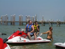 Adoptive Family Photo: Keith and Our Nephew Riding a Jetski, click to view bigger version