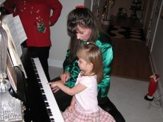 Adoptive Family Photo: Playing Piano with Our Niece, click to view bigger version