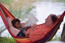 Adoptive Family Photo: Reading at the Campsite, click to view bigger version