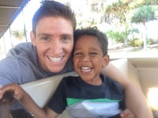 Adoptive Family Photo: Two Happy Guys on the Choo-Choo, click to view bigger version