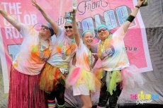 Adoptive Family Photo: Coated in Color After a 5K With Friends, click to view bigger version