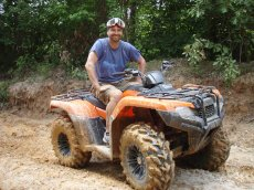 Adoptive Family Photo: Getting Dirty on the ATV, click to view bigger version