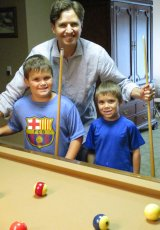 Adoptive Family Photo: Teaching Our Nephews How to Play Pool, click to view bigger version