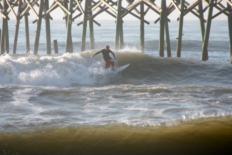 Grant Surfing by the Pier