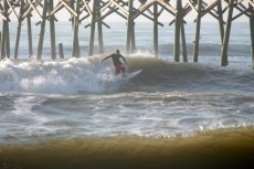 Adoptive Family Photo: Grant Surfing by the Pier, click to view bigger version