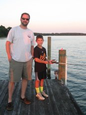 Adoptive Family Photo: James Fishing with His Nephew , click to view bigger version