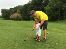 Adoptive Family Photo: Jack's First Golf Lesson with Dad