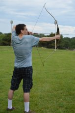 Adoptive Family Photo: Casey with His Recurve Bow, click to view bigger version