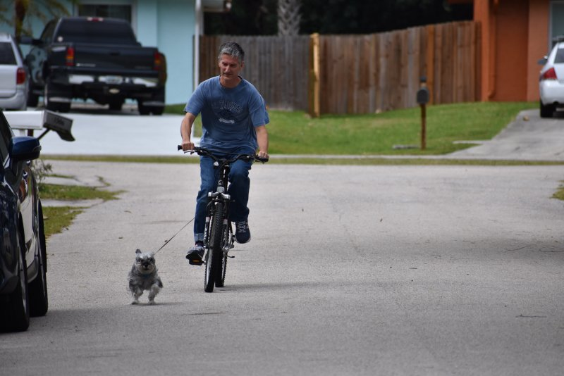 Gary Bicycling With Bella