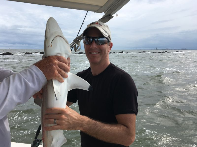 Ryan Catching Sharks While Fishing