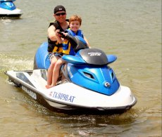 Adoptive Family Photo: Jason & Jack Having Fun on the Jet Ski, click to view bigger version