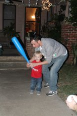 Adoptive Family Photo: Teaching Our Nephew How to Play Baseball, click to view bigger version