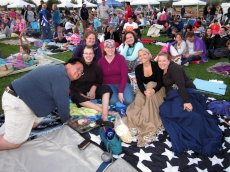 Adoptive Family Photo: Enjoying an Outdoor Movie with Friends, click to view bigger version