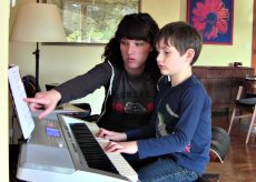 Adoptive Family Photo: Annie Helping Our Nephew Learn Piano, click to view bigger version
