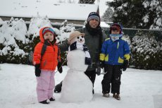 Adoptive Family Photo: Building a Snowman with Daddy, click to view bigger version