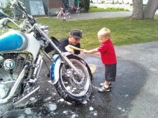 Adoptive Family Photo: Helping Uncle Bobby Clean the Bike, click to view bigger version