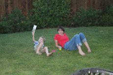 Adoptive Family Photo: Blowing Bubbles in the Backyard