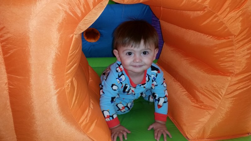 Wesley Exploring the Inflatables at a Gymnastics Center