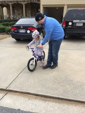 Adoptive Family Photo: Learning How to Ride a Bike with Daddy, click to view bigger version