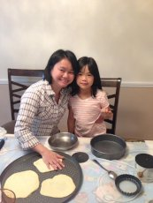 Adoptive Family Photo: Cooking with a Friend's Daughter, click to view bigger version