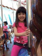 Adoptive Family Photo: Ava on the Carousel, click to view bigger version