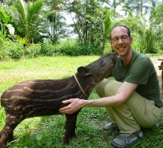Adoptive Family Photo: Rob Being Nuzzled by a Tapir in the Amazon Rainforest, click to view bigger version