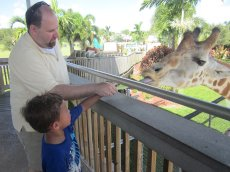 Adoptive Family Photo: Feeding a Giraffe with Our Godson, click to view bigger version