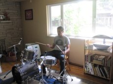 Adoptive Family Photo: Joaquin Enjoys Playing Drums, click to view bigger version