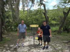Adoptive Family Photo: Playing Frisbee Golf with Grandpa, click to view bigger version