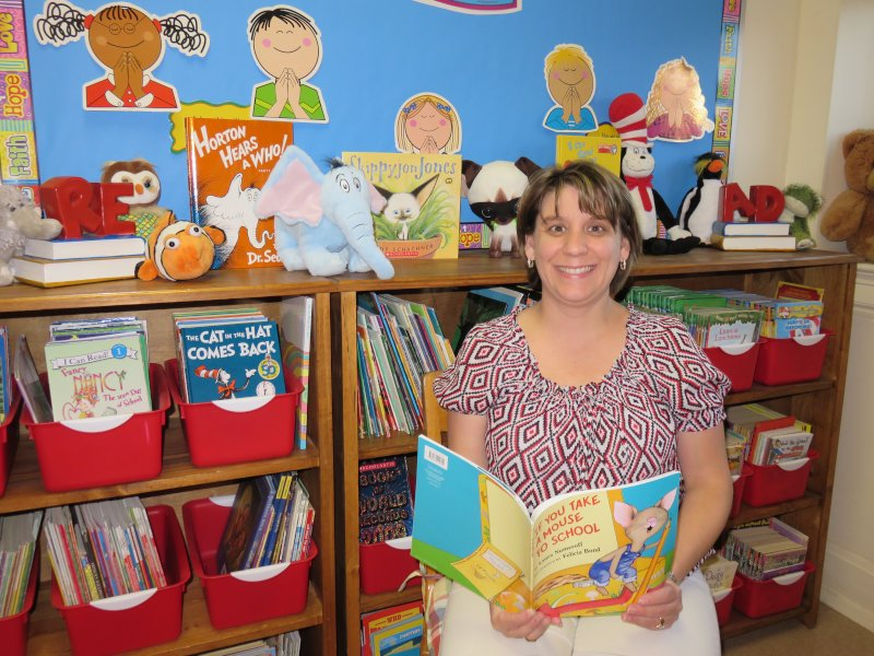 Sara with Her Classroom Library- It's Quite the Collection!