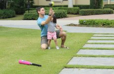 Adoptive Family Photo: Learning How to Throw a Ball, click to view bigger version