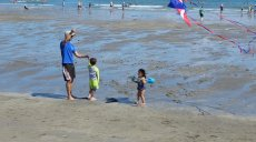 Adoptive Family Photo: Flying a Kite with Daddy, click to view bigger version