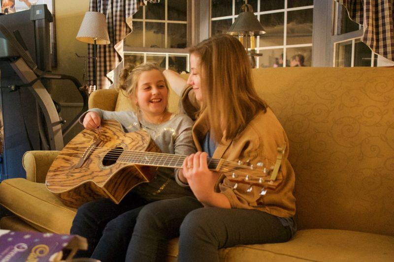 Anna Giving Our Niece Guitar Playing Tips