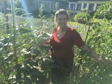 Adoptive Family Photo: Rebecca Picking Vegetables From Our Garden, click to view bigger version