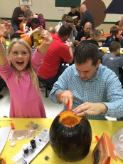 Adoptive Family Photo: Carving Pumpkins with Dad at School, click to view bigger version