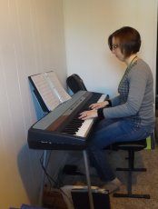 Adoptive Family Photo: Heather Playing Piano, click to view bigger version