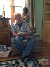 Adoptive Family Photo: Reading with Uncle Trey, click to view bigger version