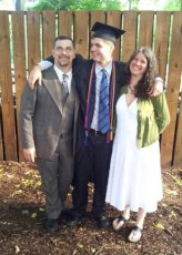 Adoptive Family Photo: Proud Parents at Jacob's Graduation, click to view bigger version