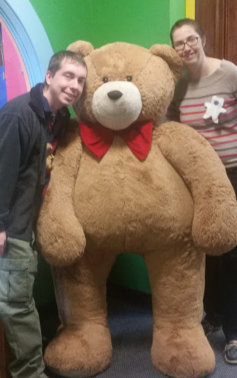 Posing with a Giant Teddy at the Teddy Bear Factory