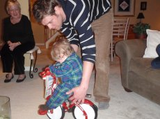 Adoptive Family Photo: David Helping Our Nephew Try Out His New Bike, click to view bigger version