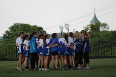Adoptive Family Photo: Claire Coaching Lacrosse, click to view bigger version