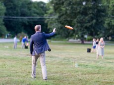 Adoptive Family Photo: Steve Playing Frisbee at a Wedding