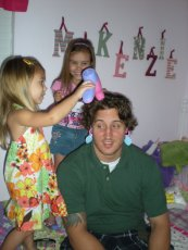 Adoptive Family Photo: Bryan Playing Barber Shop With Our Nieces, click to view bigger version