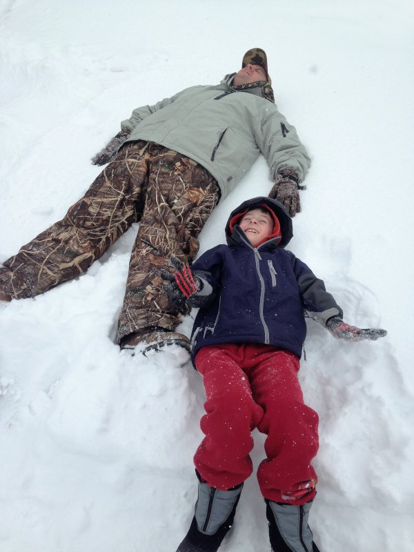 Dad Teaching Wyatt How to Make Snow Angels